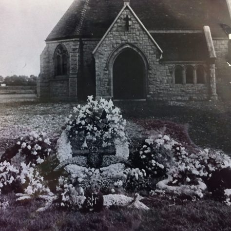 Wilfred Salmon's flower covered coffin outside the memorial chapel at Watling Street cemetery | Kent County Council Dartford Library