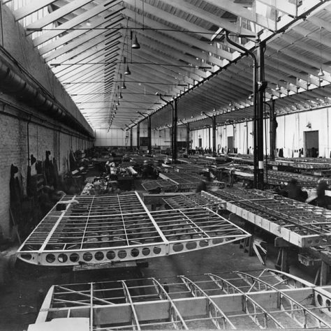 Plane Assembly Shop at Crayford. The factory stretches down a long way, with half-made wings waiting to be finished.