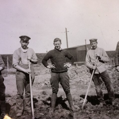 RFC salvage crew pose by huts at Joyce Green damaged by a crashed plane | Kent County Council Dartford Library