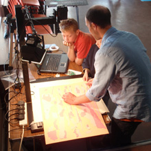 Animation sessions. A child looks on as a man shows them what to do.