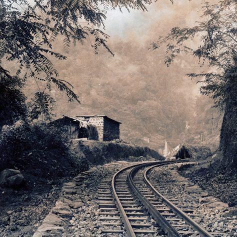 A railway line goes through mountainous territory.
